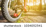 woman riding a mountain bicycle ... | Shutterstock . vector #1034052541
