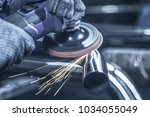 metal polishing with a hand... | Shutterstock . vector #1034055049