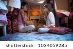 two girls in pajamas playing in ... | Shutterstock . vector #1034059285