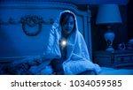 girl covered in blanket with... | Shutterstock . vector #1034059585