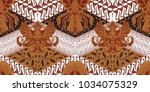 batik motif repeated pattern of ... | Shutterstock .eps vector #1034075329