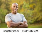 portrait of a mature fit... | Shutterstock . vector #1034082925