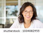 portrait of an asian woman... | Shutterstock . vector #1034082955
