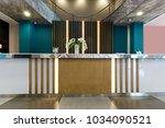 hotel reception area interior... | Shutterstock . vector #1034090521