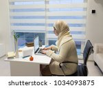 young muslim girl wotking on... | Shutterstock . vector #1034093875