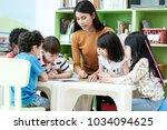 young asian woman teacher... | Shutterstock . vector #1034094625