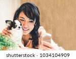 beautiful asian woman taking... | Shutterstock . vector #1034104909