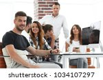 creative group of young people... | Shutterstock . vector #1034107297