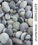 sea tropical pebbles background.... | Shutterstock . vector #1034111659