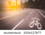 bicycle sign on the road in ca | Shutterstock . vector #1034127877