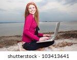 woman at beach working on laptop | Shutterstock . vector #103413641