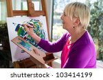 Happy Retired Woman Painting O...