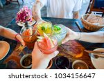 friends toasting  saying cheers ... | Shutterstock . vector #1034156647