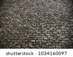 old cobble stone road surface...   Shutterstock . vector #1034160097