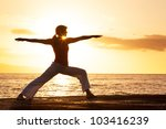 silhouette of a beautiful yoga... | Shutterstock . vector #103416239