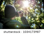 close up photographer is taking ... | Shutterstock . vector #1034173987