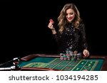 woman playing in casino. woman... | Shutterstock . vector #1034194285