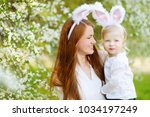 young mother and her daughter... | Shutterstock . vector #1034197249