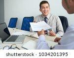 entrepreneur giving contract to ... | Shutterstock . vector #1034201395