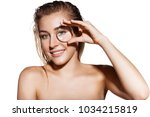 beautiful woman with magnifying ...   Shutterstock . vector #1034215819