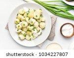 tasty potato salad with eggs... | Shutterstock . vector #1034227807