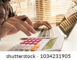 business man calculate about... | Shutterstock . vector #1034231905