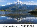 reflection of the italian alps...   Shutterstock . vector #1034245081