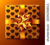 wrapped gift box with ribbon... | Shutterstock . vector #1034256811