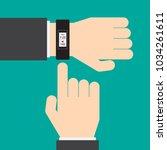 smart watch on the hand of...   Shutterstock .eps vector #1034261611