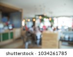blurred of coffee shop or cafe... | Shutterstock . vector #1034261785
