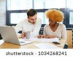 people working on notebook in... | Shutterstock . vector #1034268241