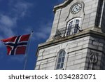 flag of norway on blue sky... | Shutterstock . vector #1034282071