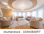 interior of a luxury living... | Shutterstock . vector #1034283097