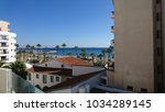 view on larnaca palm trees and... | Shutterstock . vector #1034289145