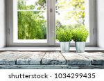 desk of free space with window... | Shutterstock . vector #1034299435