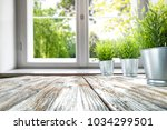 desk of free space with window... | Shutterstock . vector #1034299501