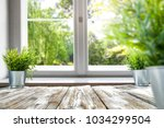 desk of free space with window... | Shutterstock . vector #1034299504