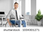 young man in wheelchair at...   Shutterstock . vector #1034301271