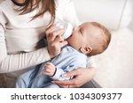 Baby Boy Drinking Milk From...