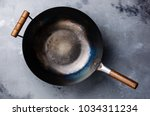 wok pan with wooden handle... | Shutterstock . vector #1034311234