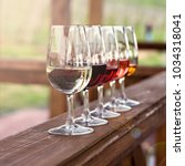 glasses with wine. red  pink ... | Shutterstock . vector #1034318041