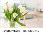 vase with bouquet of tulips on... | Shutterstock . vector #1034322217