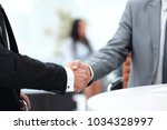 handshake manager and the... | Shutterstock . vector #1034328997