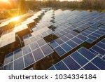 beautiful sunset over solar farm   Shutterstock . vector #1034334184