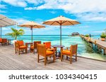 exotic restaurant on the water  ... | Shutterstock . vector #1034340415