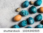 easter eggs painted by hand in... | Shutterstock . vector #1034340505