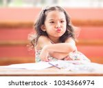 angry little girl with cross... | Shutterstock . vector #1034366974