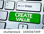 Small photo of Handwriting Announcement text showing Create Value. Business concept for Creating Motivation written on blue key the keybord background.