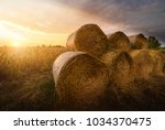 hay roll bales on countryside... | Shutterstock . vector #1034370475
