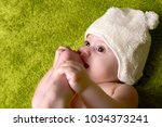 joyful baby boy on green... | Shutterstock . vector #1034373241